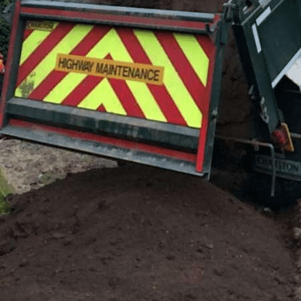 Screened topsoil alternative being delivered